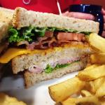 Turkey clubhouse with bacon, cheese, lettuce & tomatoes