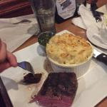 Nice presentation salmon over mashed potatoes, chimmi steak and crab Mac n cheese