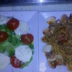 Caprese salad and spaghetti red clams