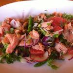 Glazed salmon flakes on baby endive w ruby grapefruit, asparagus spears, spanish onion, bean sho