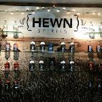 Hewn behind bar