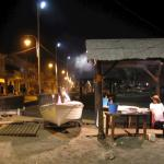 Nightview of fish grilling on the beach