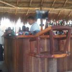 chair at bar with sports tv background don ernestos puerto morelos beaches