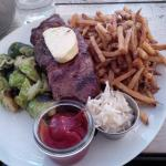 12oz Prime Angus Strip Loin, Medium Well, with fries, and brussels sprouts. Generous portion!
