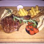 Aged beef rib aptly named Tomahawk... Absolutely out of this world!
