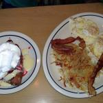 suffed french toast with vanilla & glazed strawberries and eggs bacon and hashbrown