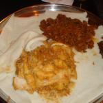 two dishes served on Injera (sides eaten by us :)