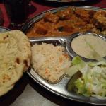 This is Badam Jalfrazi with chicken with some garlic Naan bread.