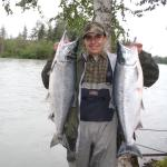 Young Michael Bangos with a couple beautiful Kenai River Red Salmon!