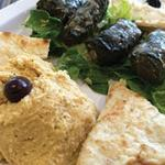 PIKILA - a sampler platter of Dolmathakia (stuffed grape leaves), hummus and tzatziki.