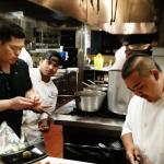 Executive Chef Jason Ichiki (in black) works with his team preparing creative Asian fusion dishe