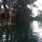 River by lodge with rope swing that opens up into Caribbean Sea.
