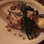 Grilled halibut & crabmeat (special) with wild rice, asparagus,and broccoli with sauce on the si