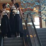 Brides maids coming down the escalator in Marriott