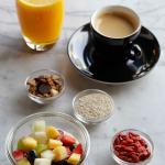 Fresh Breakfast with Yoghurt, Fruit, Grenola, Orange Juice and a Long Black