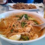 Malaysian Curry Laksa with Chicken in front and Malaysian Fried Noodles with Beef in back.