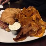 BLT on a croissant with sweet potato chips