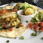 Great food and atmosphere. We both loved our dishes. I had the special tacos with pineapple and