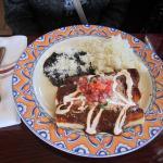 Enchiladas Shredded chicken, mole sauce, crema, pico de gallo, cottage cheese, white rice, black