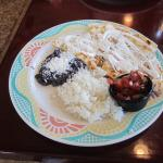 Sautéed wild mushrooms in a quesadilla with jack cheese, white rice, black beans, sour cream.