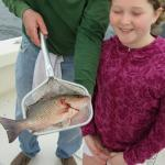 Evelyn with the first fish of the day. Red snapper.