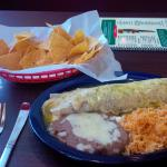 Green chile burrito with side of rice and beans, plus chips and salsa