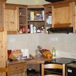 Vue de la cuisine ouverte sur salon