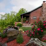 The Arkansas Cabin is a guest favorite with its outdoor hot tub deck and 30-mile view of Buffalo