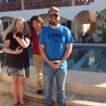 Kim, holding Vaca, our delightful housekeeper Mary, and Cornelio, proprietor.