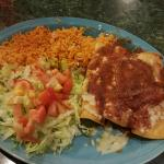 Three chicken enchiladas with rice and lettuce (salad)