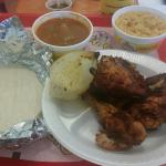 Half Chicken with onion, rice, beans and corn torts