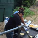 Yolanda and her crew from were preparing handmade tortillas for our wedding taco bar.