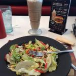 Taco Salad with Mocha Milkshake, topped with whip cream and a cherry