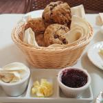 A basket of scones and it's condiments below. Try to finish that! Oh so good:-)