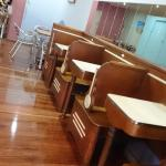 A row of old school diner booths; more (modern) seating at rear.