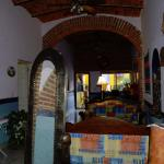 Entrance and common-area reading room at Ajijic Suites on Hidalgo