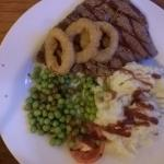 10oz Rump steak, three onion rings, small portion of Mash and the saddest half a tomato ever