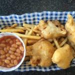 Childrens portion of cod bits, chips and beans.