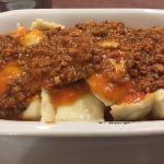 Ravioles de ricota con salsa bognesa