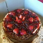 Chocolate cake with strawberry covered cheesecake on top
