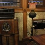 Living room with antique radio and cat