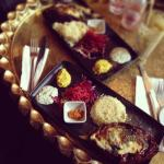 'Aubergine boat' - baked aubergine stuffed with cheese and spinach; salad, rice, sauces.