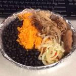 Black beans, yellow rice, pernil (pulled pork), onions and a beets & string bean salad.