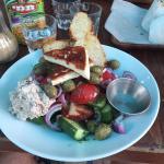The Greek salad: Chunky cut veggies, olives, grilled halloumi, lemon-olive dressing, toast & tun
