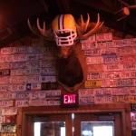 The Wisconsin Green Bay Packers Moosehead surrounded by license plates sits atop the inside entr