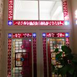 The stained glass foyer door