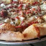 This is a white pizza pie with sausage and red sauce added. Delish!