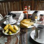 First breakfast course, Nescafe or local tea, pineapple, mango, banana, then eggs and toast