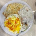 2 eggs over easy with hot sauce, big biscuit with gravy, hash browns