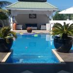 Pool just next to the large alfresco dining and living room area.
